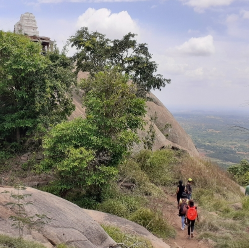 11Trekkers walking past Shankareshwara temple at Uttari Betta